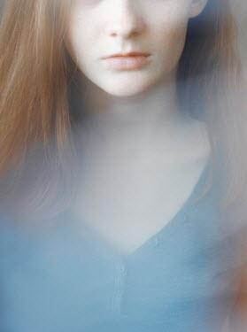 Svitozar Bilorusov CLOSE UP OF SERIOUS GIRL WITH RED HAIR Women