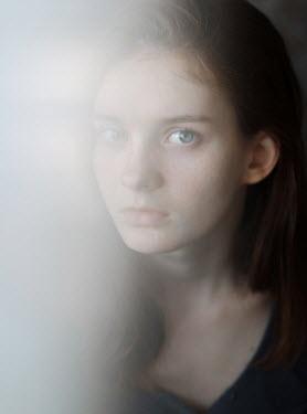 Svitozar Bilorusov CLOSE UP OF BLURRED STARING GIRL Women