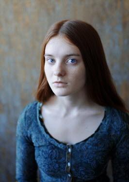 Svitozar Bilorusov CLOSE UP OF STARING GIRL WITH RED HAIR Women
