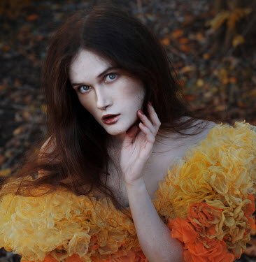 Svitozar Bilorusov STARING WOMAN WITH YELLOW FRILLY DRESS OUTDOORS Women
