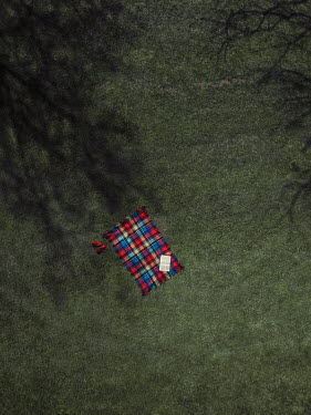 Magdalena Russocka aerial view of empty picnic blanket on grass