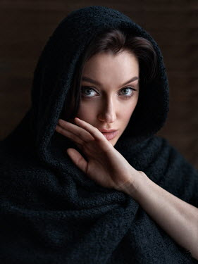 Alexey Kazantsev CLOSE UP OF BRUNETTE WOMAN COVERED BY SHAWL Women