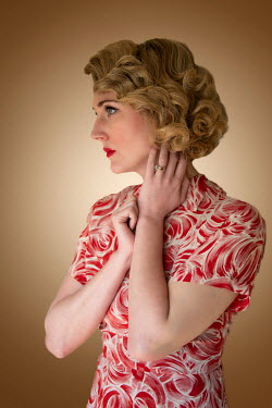 Elisabeth Ansley CLOSE UP OF RETRO WOMAN IN RED PATTERNED DRESS Women
