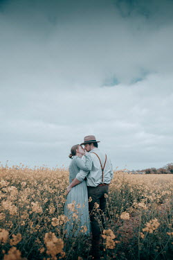 Rekha Garton COUOLE KISSING IN FIELD OF YELLOW FLOWERS Couples