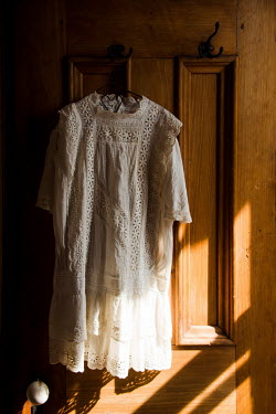 Elisabeth Ansley WHITE LACE NIGHTDRESS HANGING ON DOOR Miscellaneous Objects