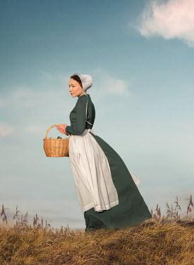 Joanna Czogala HISTORICAL MAID HOLDING BASKET IN FIELD Women