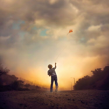 Jessica Drossin BOY FLYING KITE AT SUNSET Children