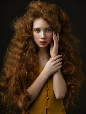 Alexey Kazantsev CLOSE UP OF GIRL WITH LONG CURLY RED HAIR Children