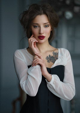 Alexey Kazantsev Young woman with tattoo in dress