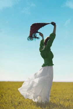 Ildiko Neer Historical woman standing in field with scarf Women