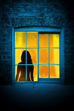Magdalena Russocka silhouette of woman in window of old building at night