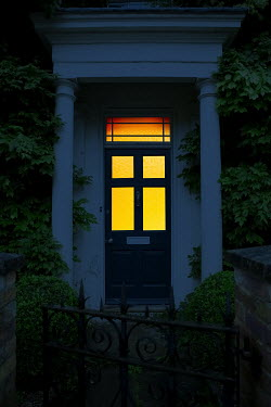 Magdalena Russocka illuminated entrance to old house at night