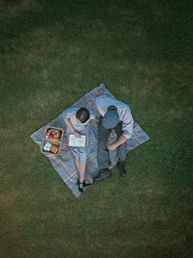 Mary Wethey Couple sitting on picnic blanket from above