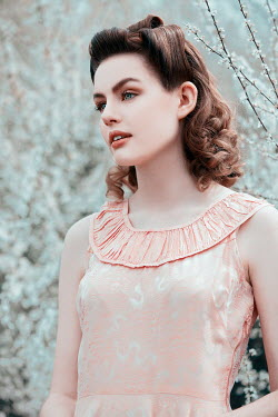 Rekha Garton Young woman in vintage pink dress