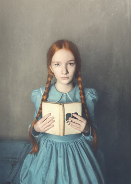 Anna Buczek Girl with pigtails holding book