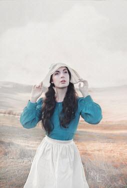 Anna Buczek Young woman in vintage lace bonnet