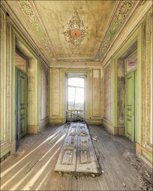 Christophe Dessaigne Broken door to balcony in abandoned mansion