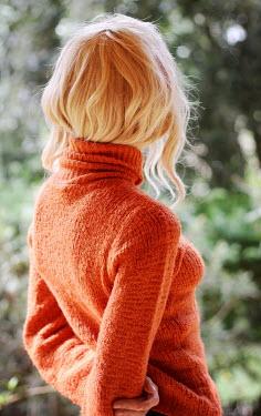 Irene Lamprakou Young woman in orange sweater