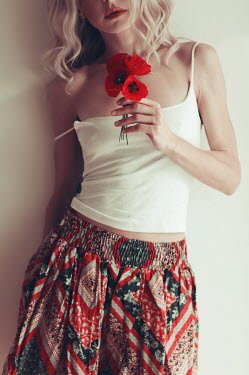 Irene Lamprakou Young woman holding poppies