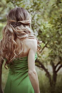 Irene Lamprakou Young woman in green dress by tree