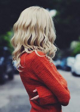 Irene Lamprakou Young woman in red sweater