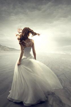 ILINA SIMEONOVA Woman in white dress on beach