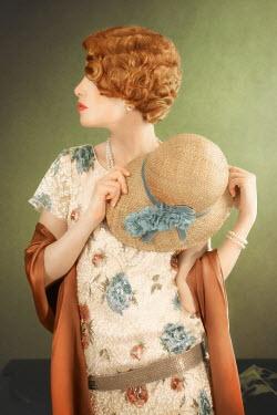 ILINA SIMEONOVA Young woman in 1920s dress holding straw hat