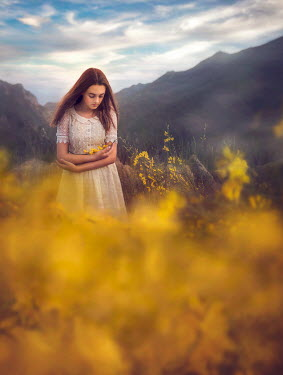 Jessica Drossin Teenage girl holding yellow flowers