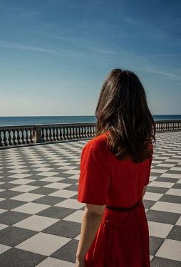 Nikaa BRUNETTE WOMAN ON TERRACE WATCHING SEA Women