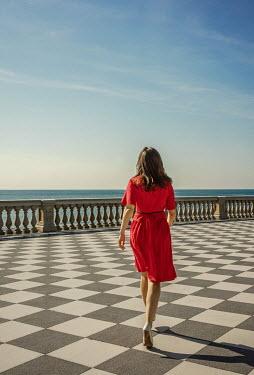 Nikaa BRUNETTE WOMAN WALKING ON TERRACE BY SEA Women