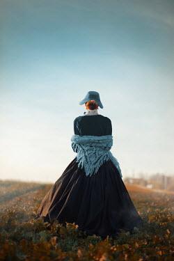 Ildiko Neer Historical woman standing countyside