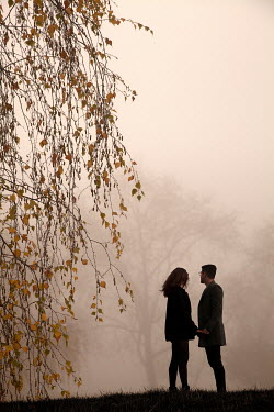 Miguel Sobreira COUPLE HOLDING HANDS IN FOGGY COUNTRYSIDE Couples