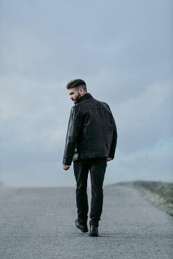 Magdalena Russocka modern man walking on road