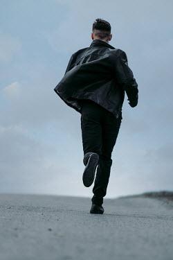 Magdalena Russocka modern man running on road