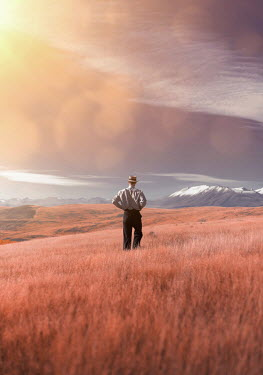 Mary Wethey PIONEER MAN IN COUNTRYSIDE WITH SNOWY MOUNTAINS Men