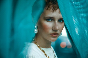 Maria Yakimova WOMAN WITH PEARL EARRINGS BEHIND TURQUOISE CURTAINS Women