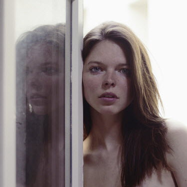 Anna Rakhvalova WORRIED BRUNETTE GIRL WATCHING AT WINDOW Women