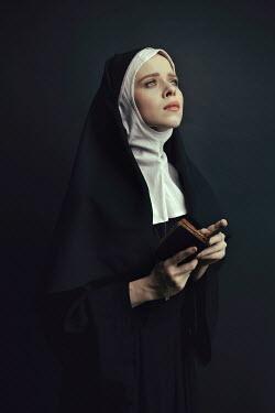 Dorota Gorecka SERIOUS NUN STANDING HOLDING BIBLE Women