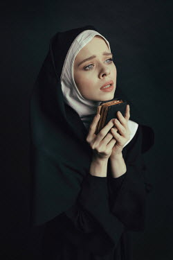 Dorota Gorecka UNHAPPY NUN IN HABIT HOLDING BIBLE Women