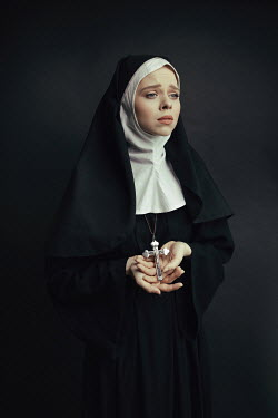 Dorota Gorecka UNHAPPY NUN IN HABIT HOLDING CRUCIFIX Women