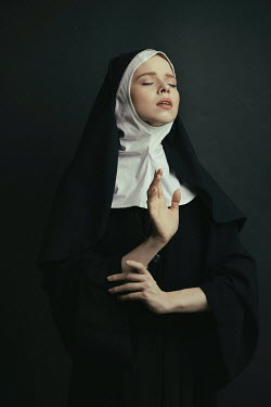 Dorota Gorecka SERIOUS NUN IN HABIT PRAYING Women