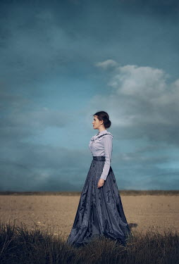 Magdalena Russocka historical woman standing in field with mountainscape