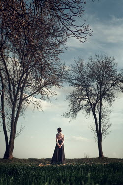 Magdalena Russocka historical woman standing by trees