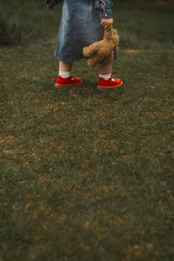 Shelley Richmond LITTLE GIRL CARRYING TEDDY IN GARDEN Children