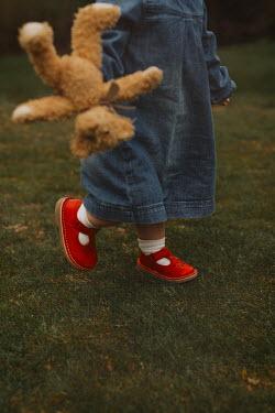 Shelley Richmond LITTLE GIRL PLAYING WITH TEDDY IN GARDEN Children