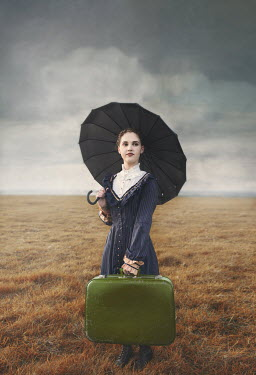 Anna Buczek GIRL WITH UMBRELLA CARRYING SUITCASE IN COUNTRYSIDE Children
