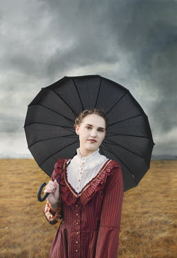 Anna Buczek GIRL WITH UMBRELLA IN STORMY COUNTRYSIDE Children