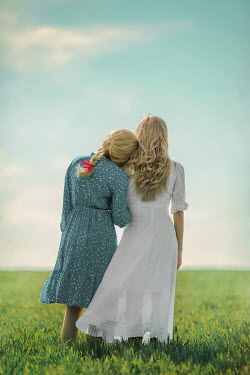 Ildiko Neer Two blonde women standing in summery field Women