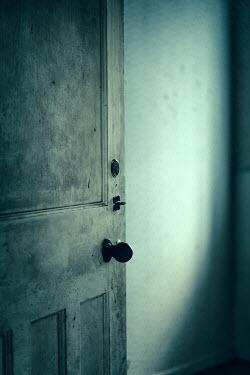 Magdalena Russocka open door in old derelict house