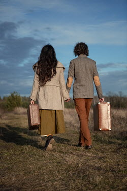 Magdalena Russocka vintage couple with suitcases in countryside